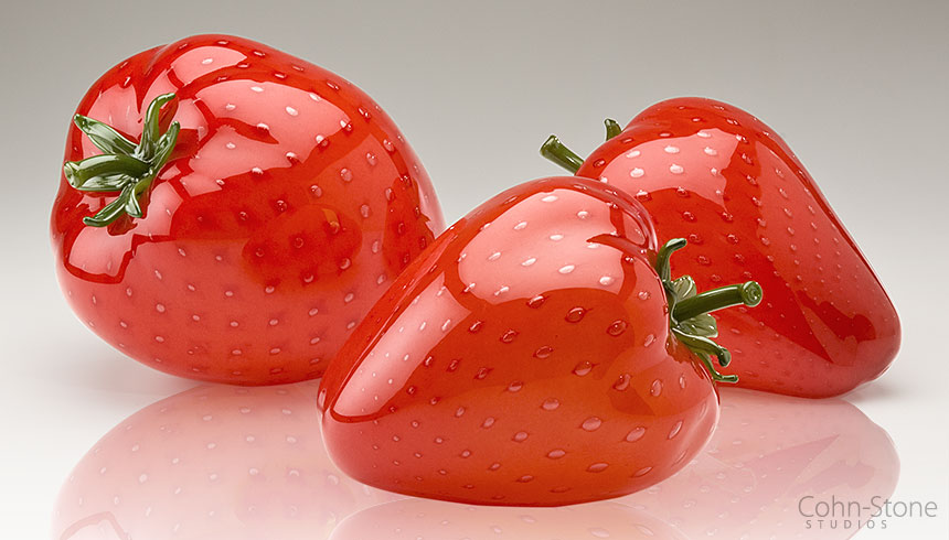 Larger-than-life hand blown glass strawberries by glass artists Michael Cohn and Molly Stone